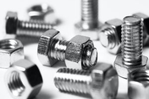Collection of shiny metal nuts and bolts